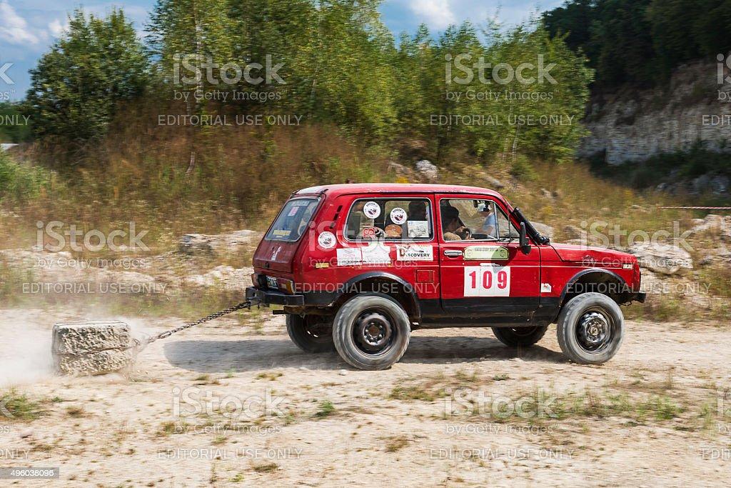Off-road vehicle brand VAZ-NIVA overcomes the track stock photo