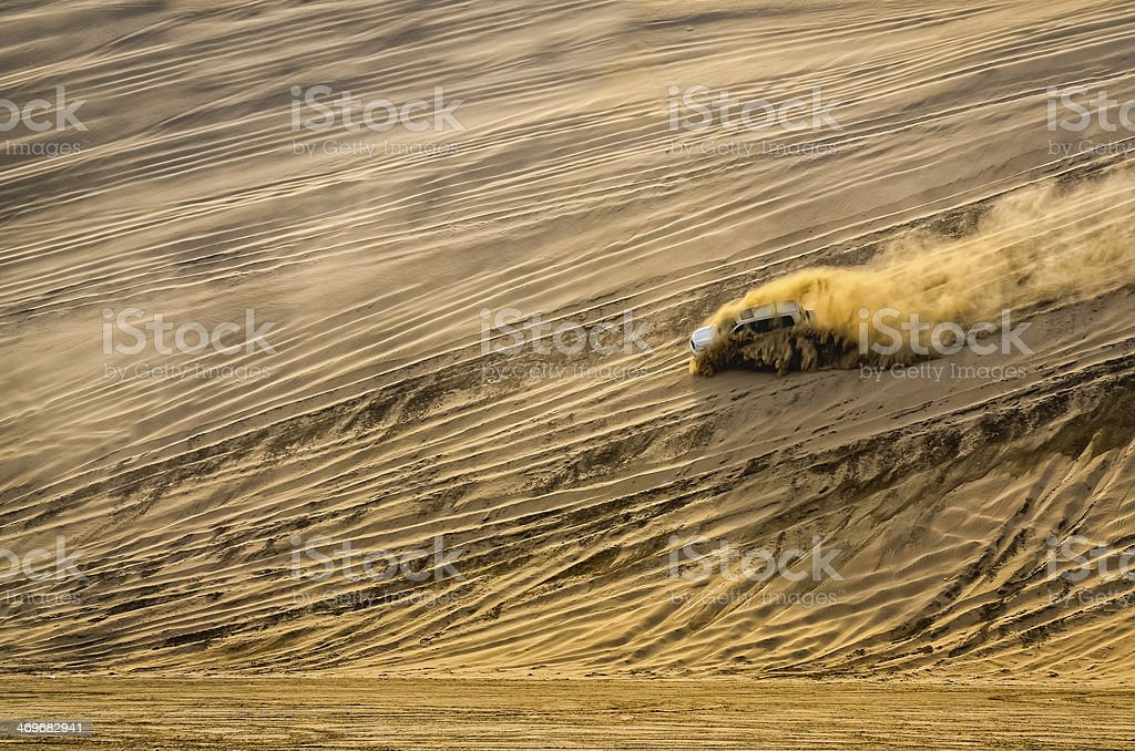 Off-road vehicle driving in the sand desert royalty-free stock photo