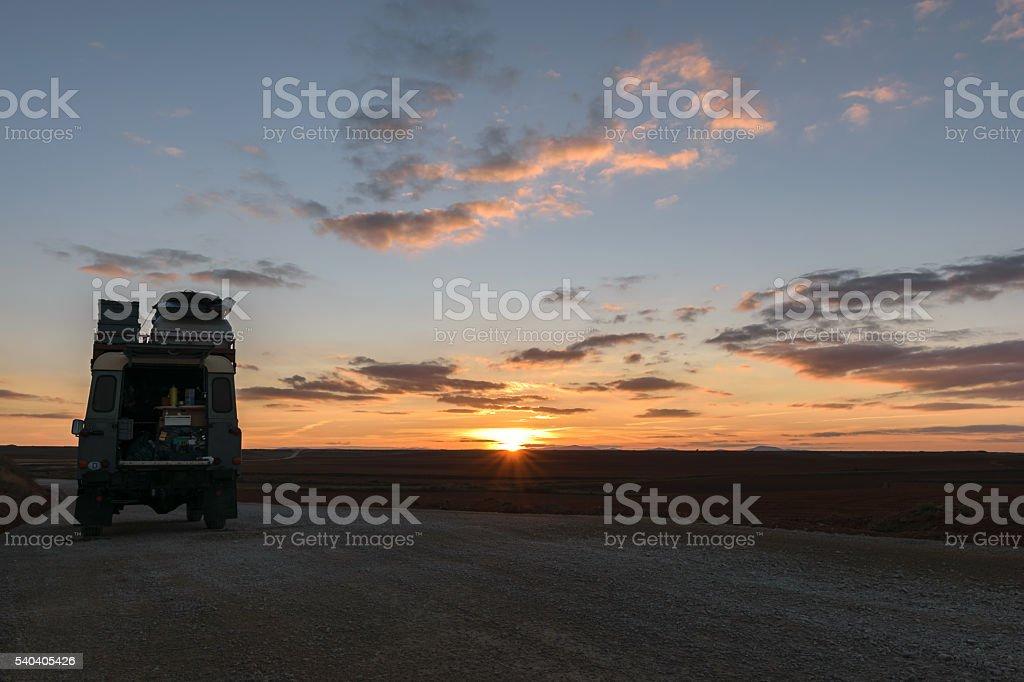 Off-road vehicle oldtimer sunset stock photo