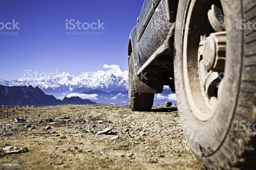 off-road vehicle on mountain peak royalty-free stock photo