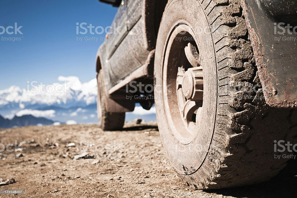off-road vehicle on mountain peak stock photo
