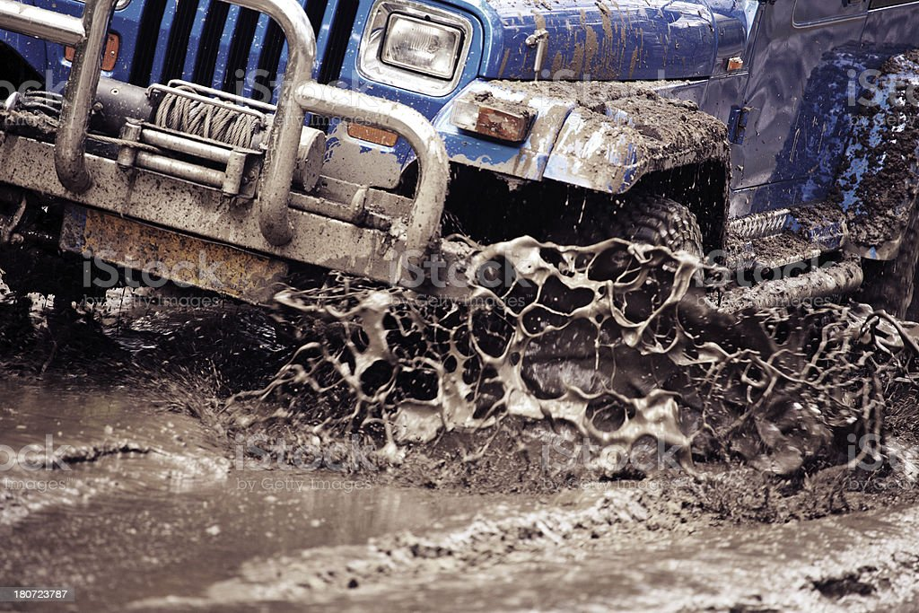 off-road vehicle riding in dirt stock photo