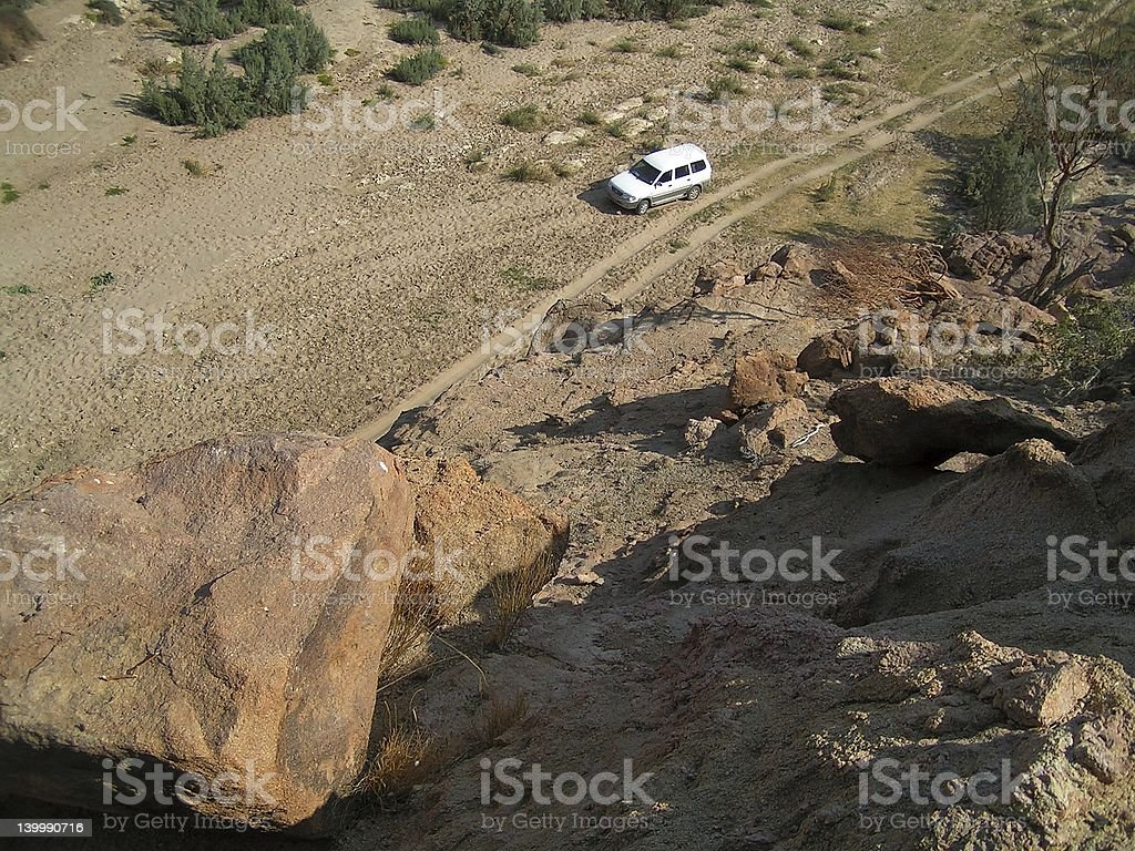 Offroader in desert valley stock photo
