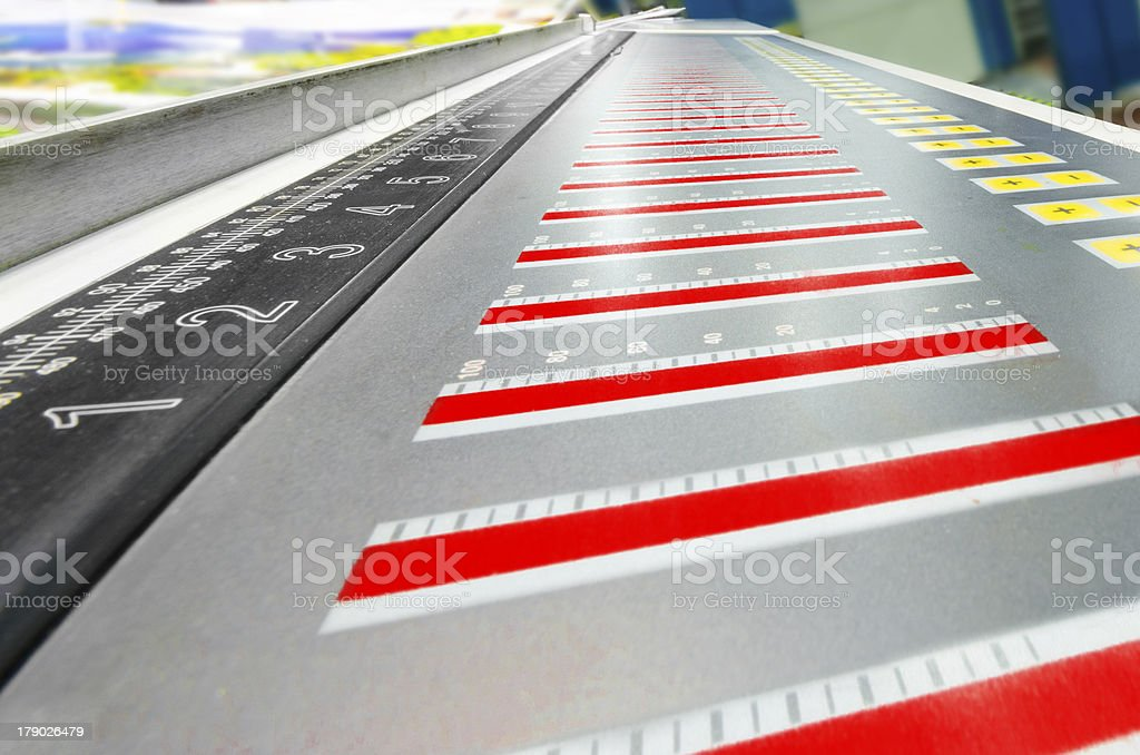 offset machine press fountain control key unit and cmyk stripe stock photo