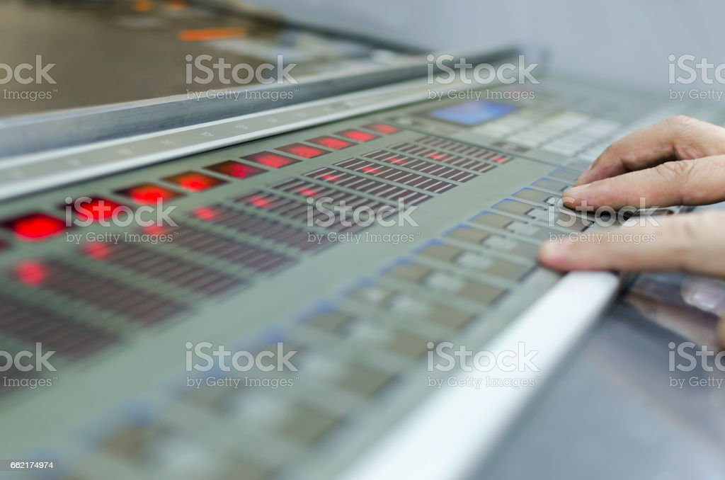 offset machine press print run at table, hands on fountain key control unit close-up stock photo