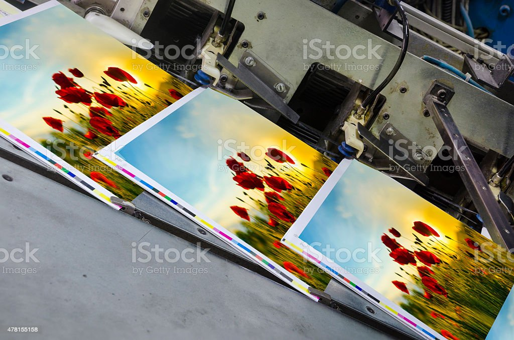 offset machine press unit with magazine in raw stock photo