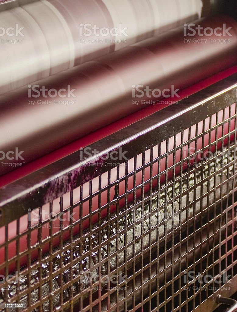 offset printing plate and roller train - red unit stock photo