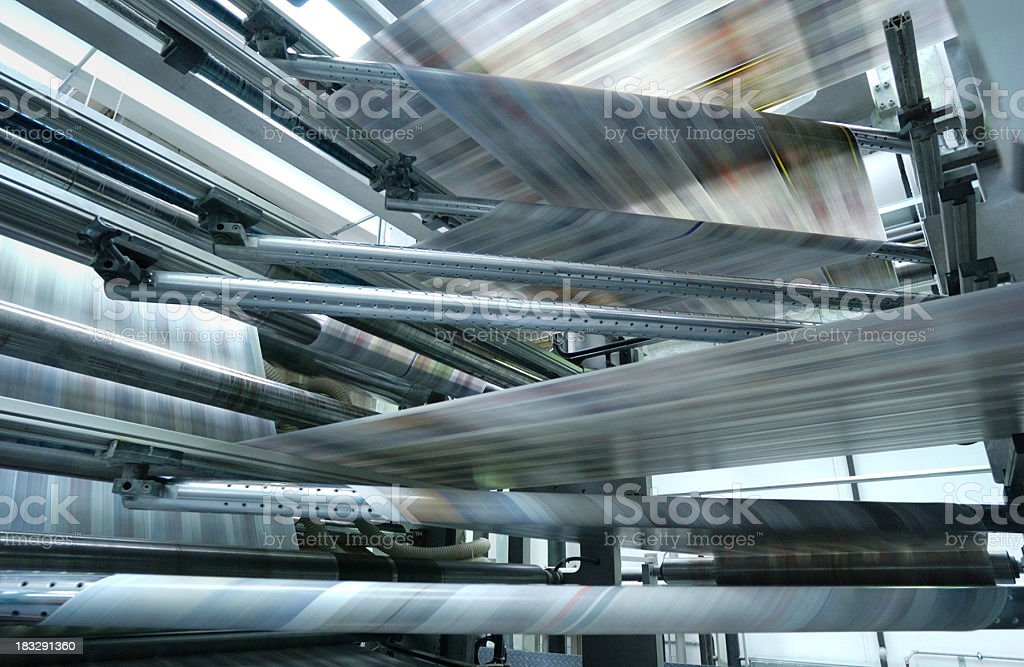 Offset printing press machine running at high speed royalty-free stock photo