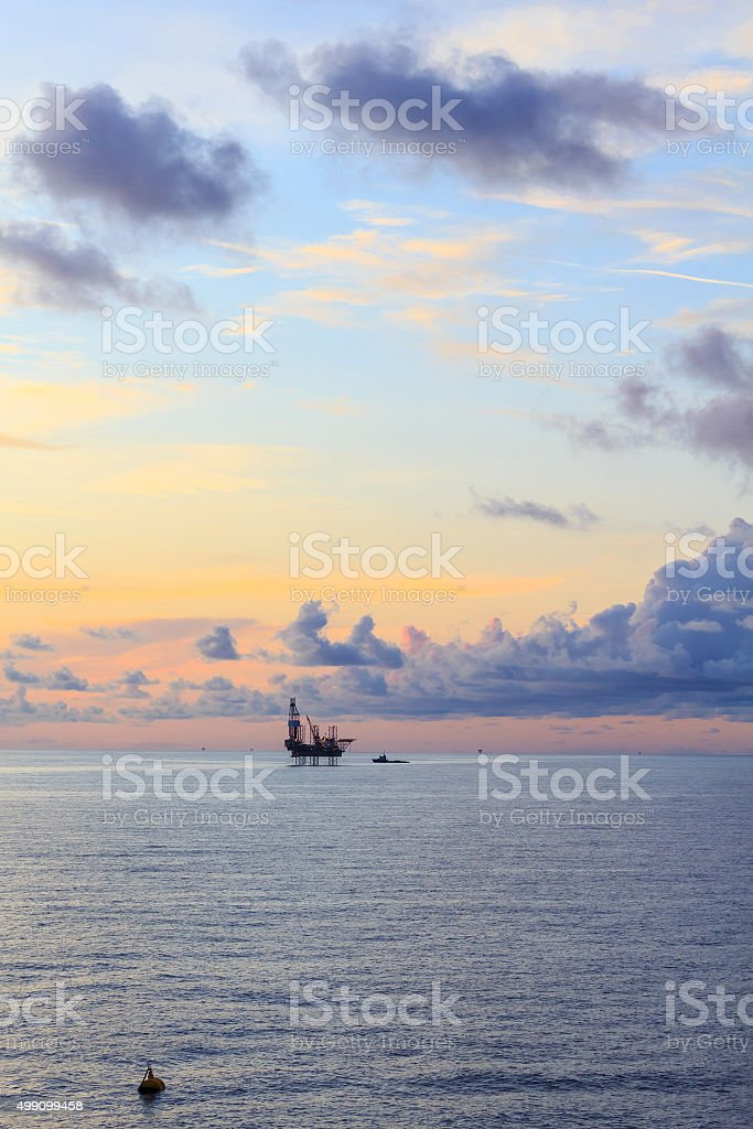 Offshore jack up drilling rig in the middle of the ocean stock photo