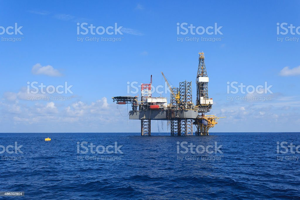 Offshore Jack Up Drilling Rig Over The Production Platform stock photo