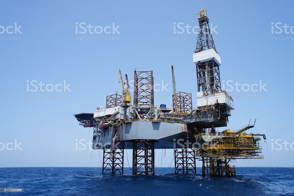 Offshore Jack Up Rig and The Production Platform stock photo