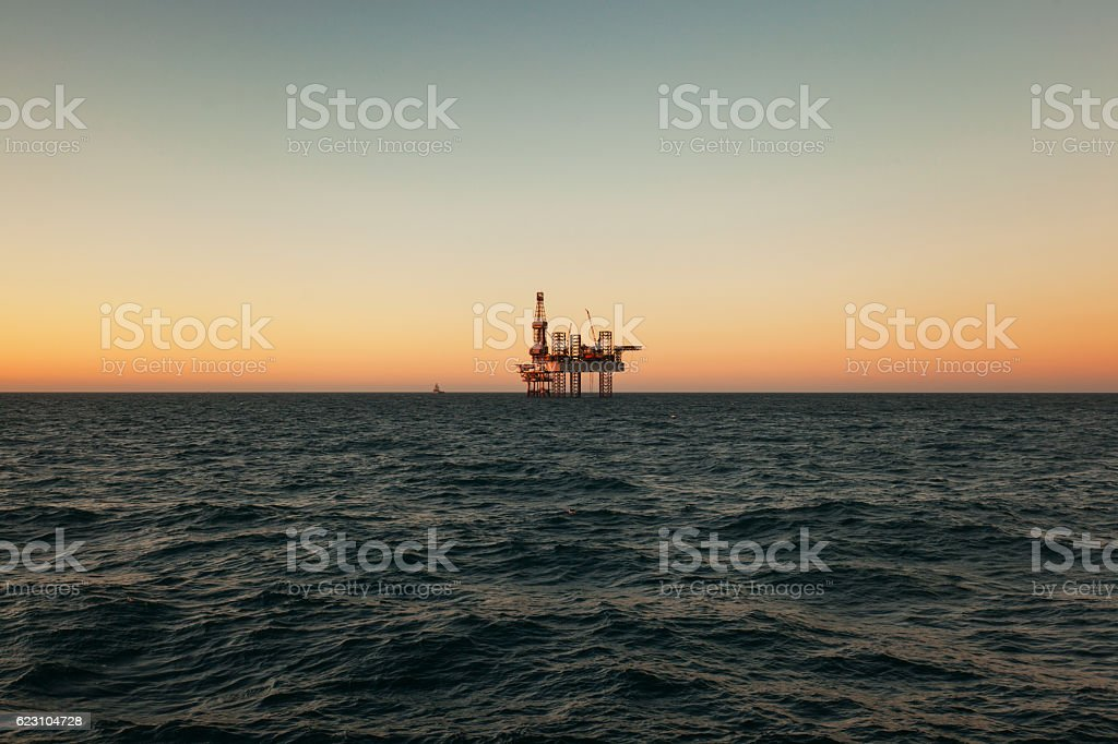 Offshore Jack Up Rig in The Middle  Sea at Sunset stock photo