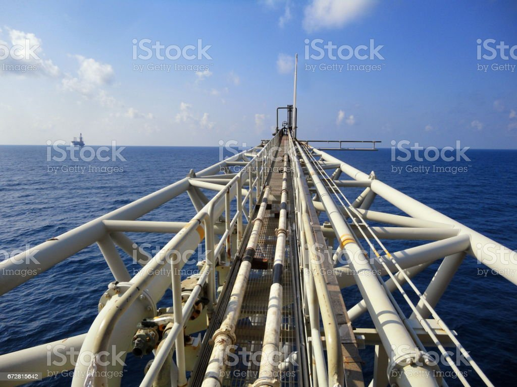 Offshore oil and gas production platform flare boom stock photo