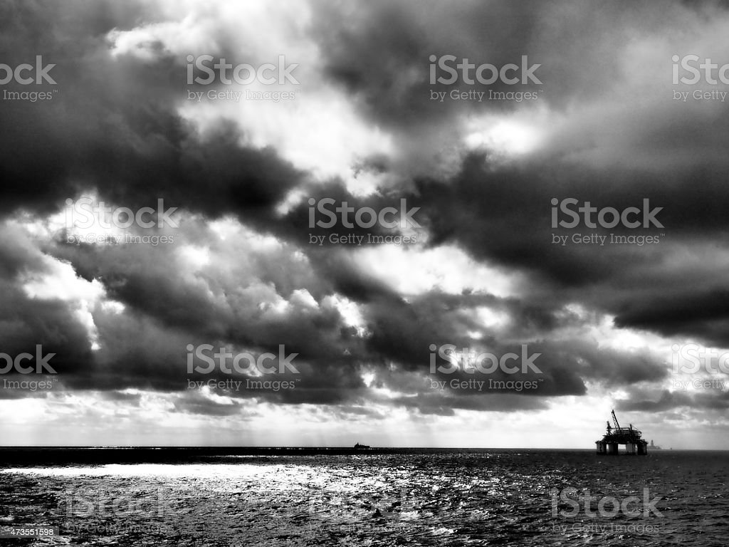 Offshore oil drilling platform or rig, dramatic sky stock photo