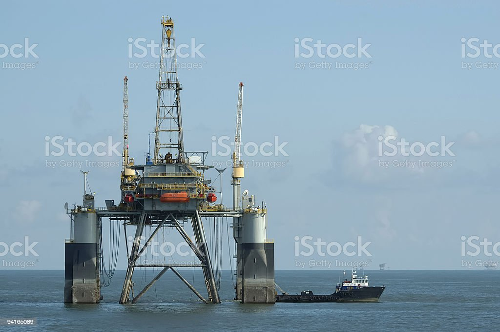 Offshore Oil Rig and Supply vessel. royalty-free stock photo