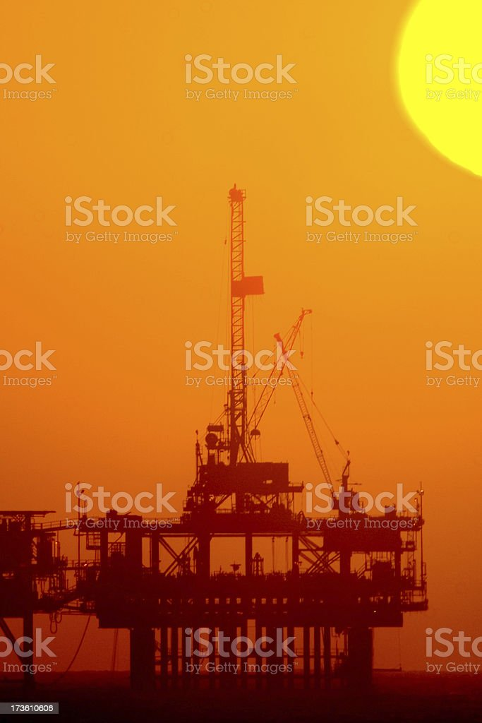 Off-shore Oil rig at sunset royalty-free stock photo