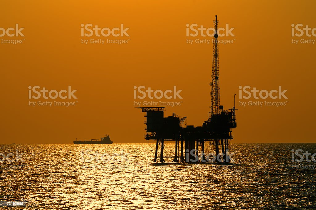 Offshore oil rig at sunset stock photo