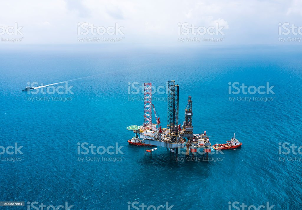 Offshore oil rig drilling platform in the gulf of Thailand stock photo