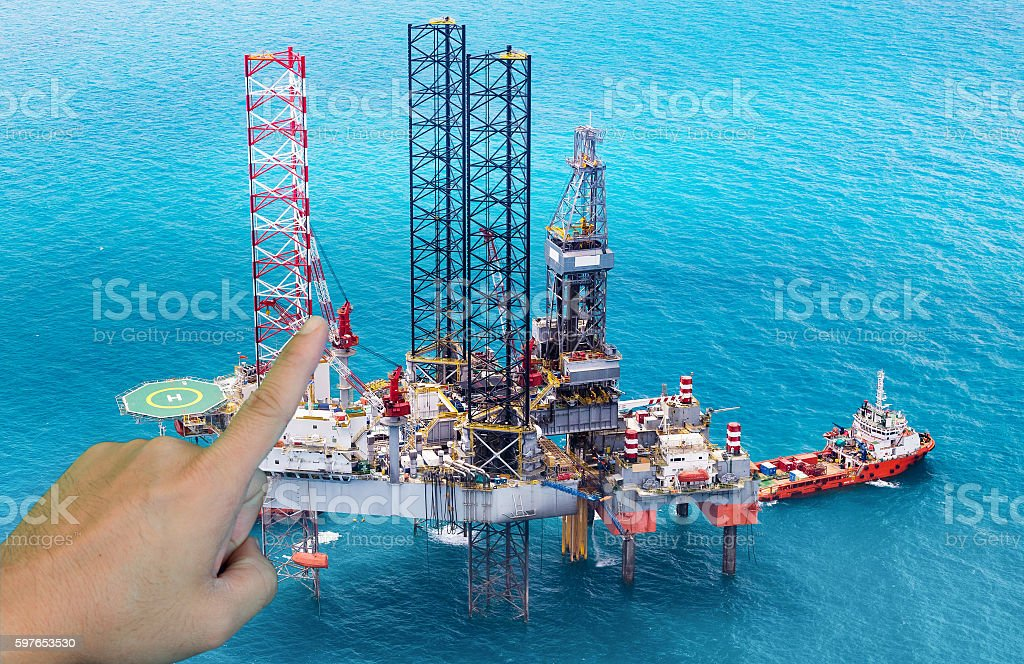 Offshore oil rig drilling platform in the gulf stock photo