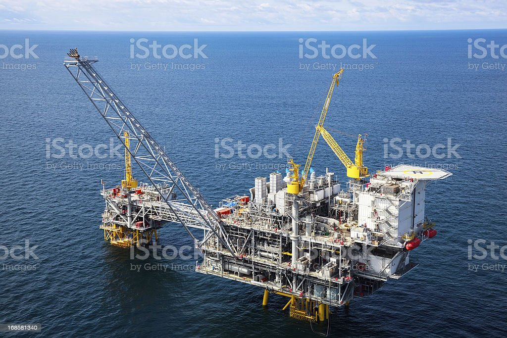 Offshore oil rig in a large body of water stock photo