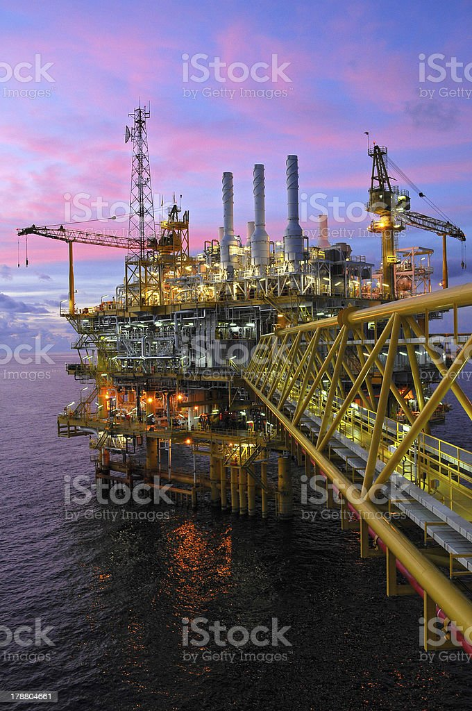 Offshore oil rig pictured at dusk stock photo