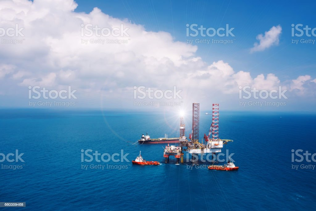Offshore oil rig platform in the gulf from aerial view. stock photo