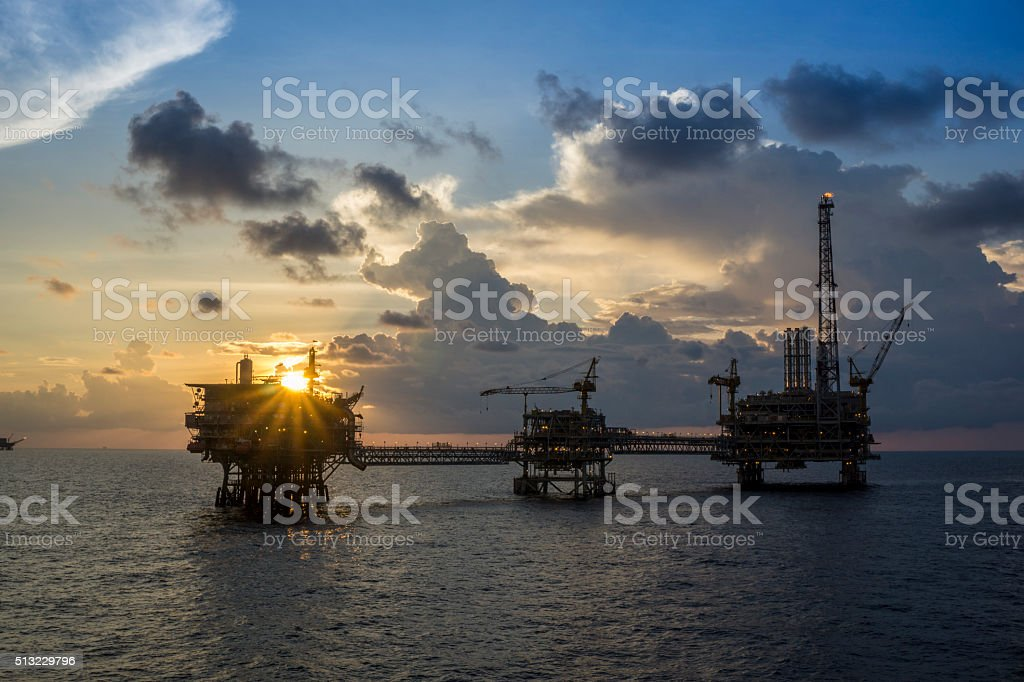 Offshore oil rigs or oil and gas production platforms stock photo