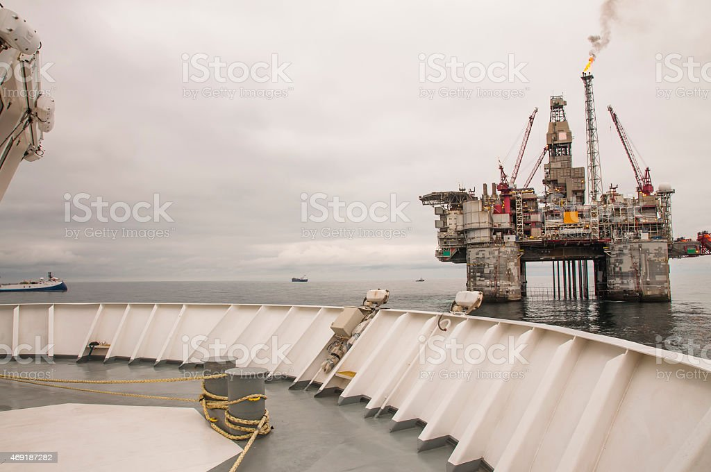 Offshore Platform and vessel stock photo