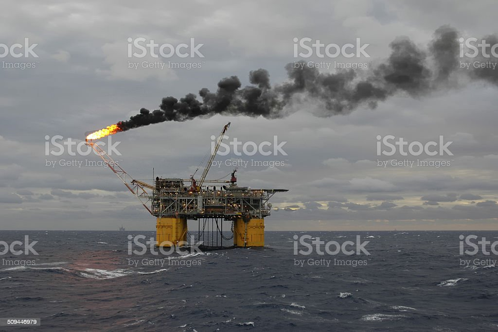 Offshore production platform flaring off gas. stock photo