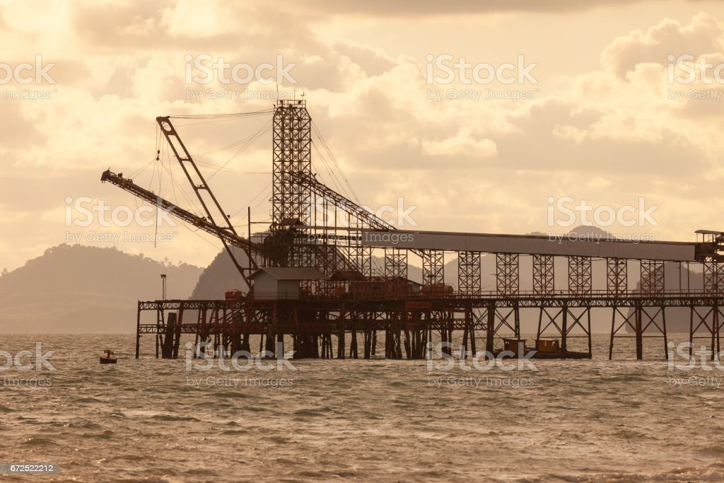 Offshore Production Platform In the Middle of Ocean. - Silhouette background. stock photo