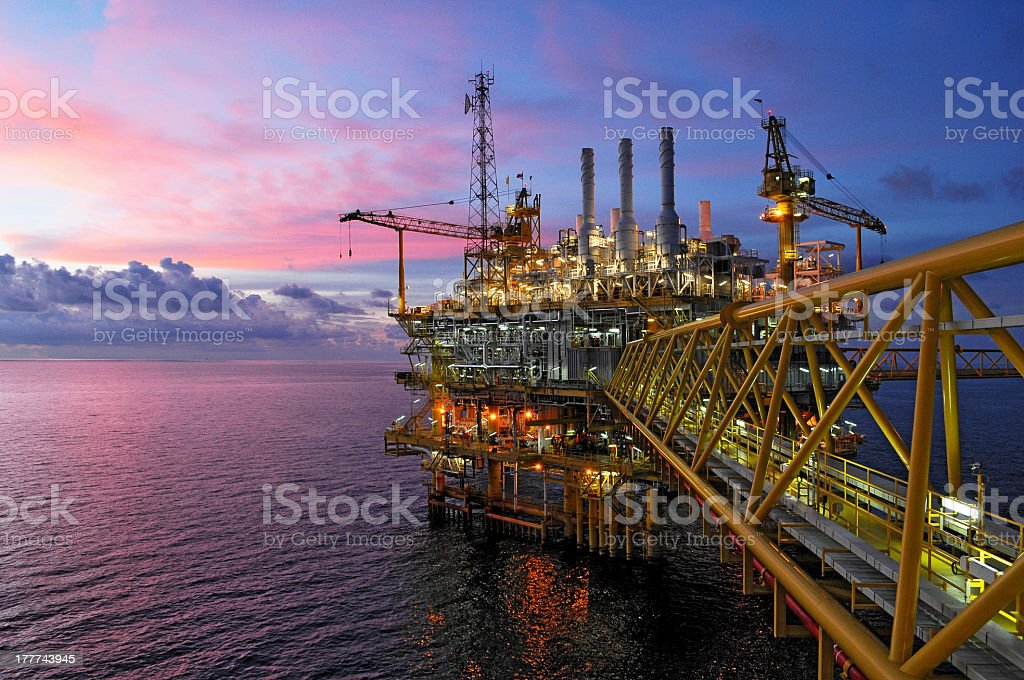 offshore rig in twilight stock photo