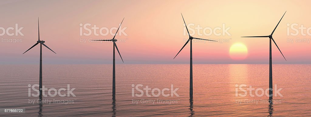 Offshore wind farm at sunset stock photo
