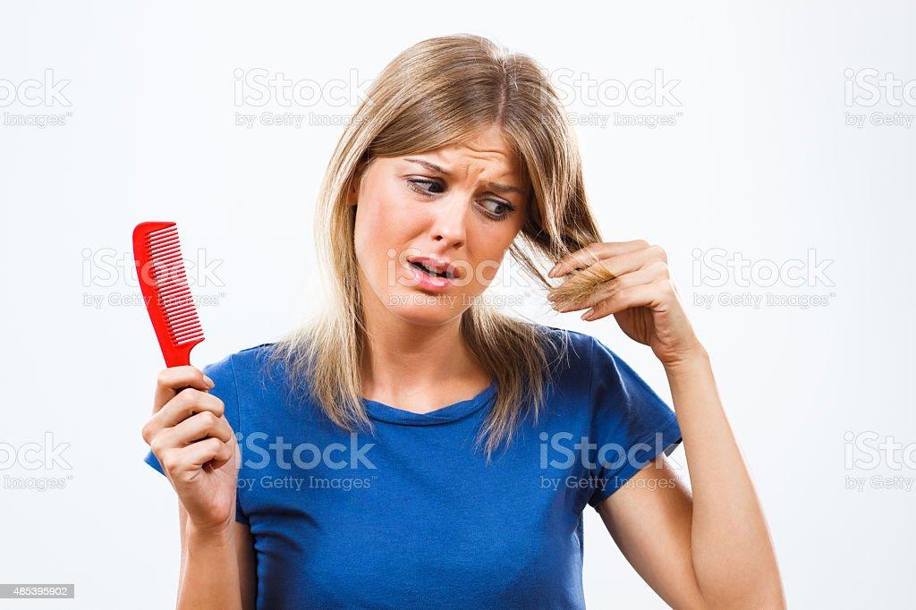 Oh no I am loosing my hair! stock photo