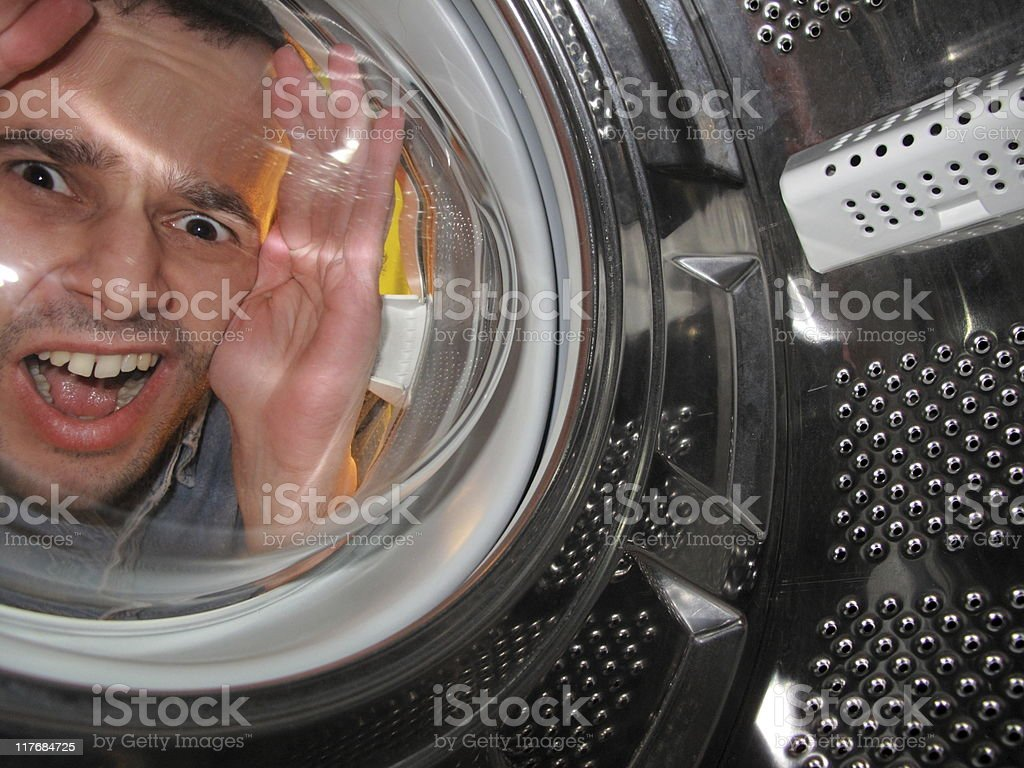 Oh no! That's my camera inside the washing machine!!! (series) stock photo