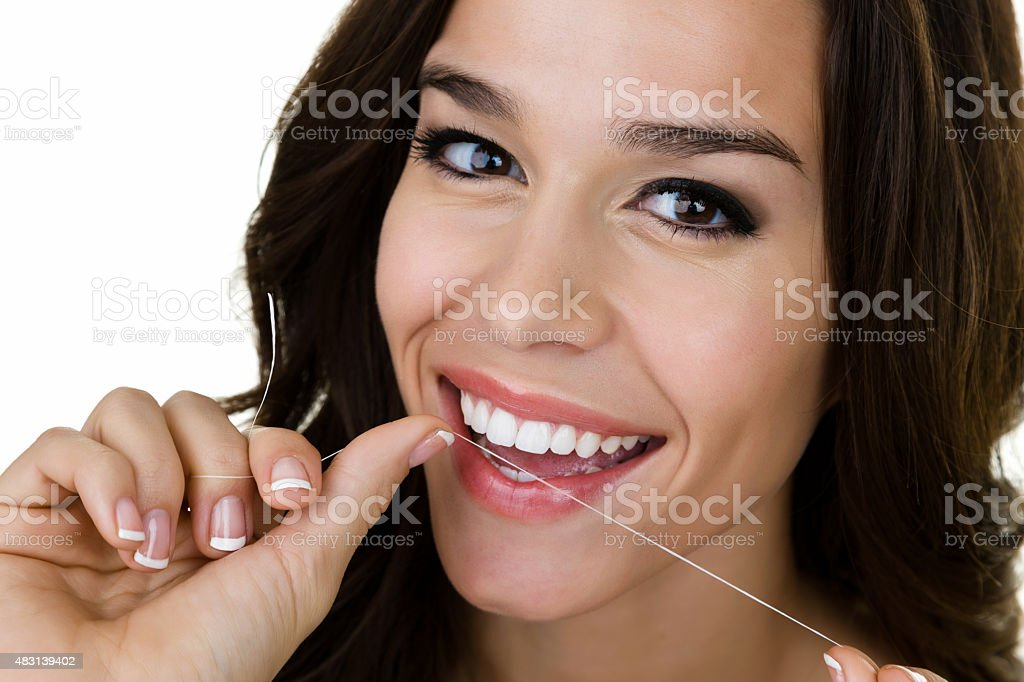 Oh what a smile. Girl flossing her teeth stock photo
