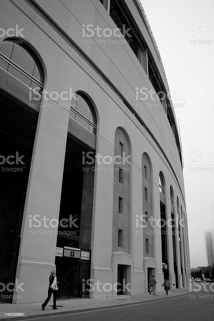 Ohio Stadium and woman walking stock photo