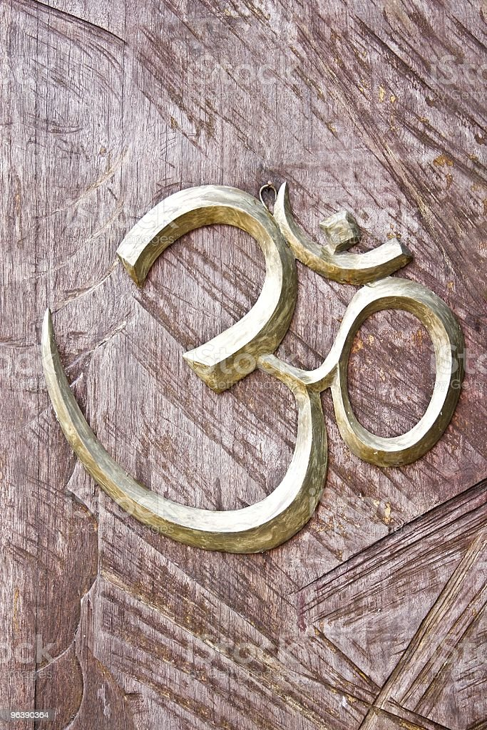 Ohm sign on a wood background royalty-free stock photo