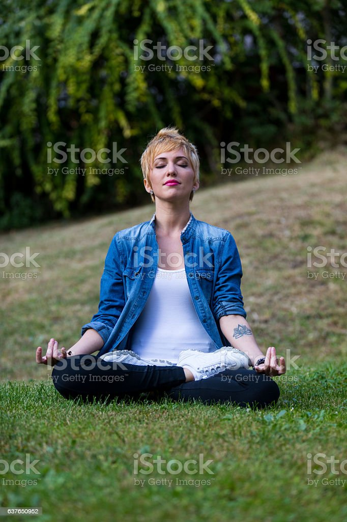 ohmm meditation girl in the park stock photo