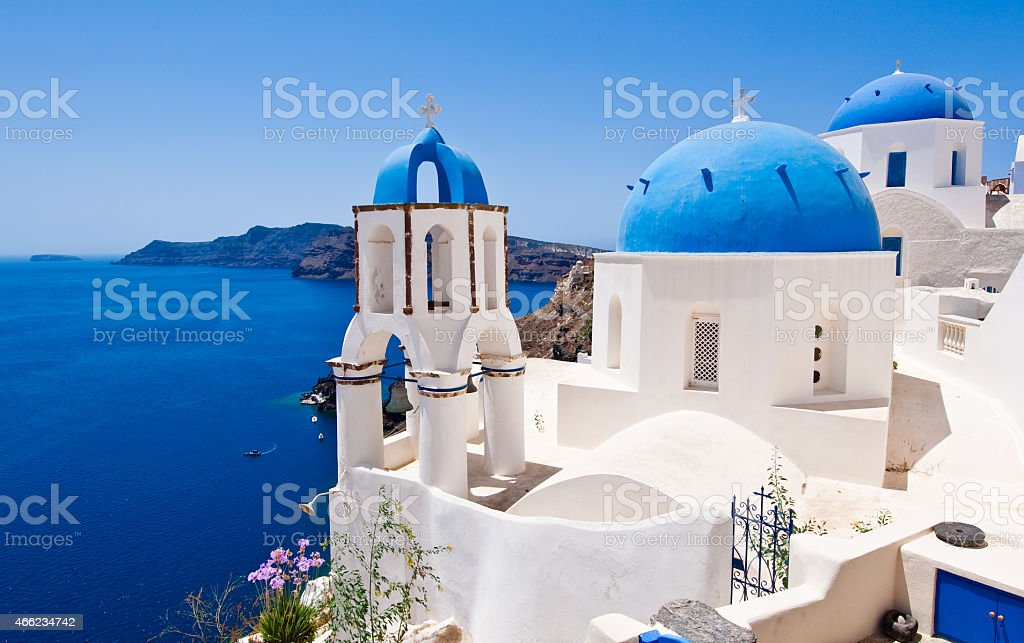 Oia Orthodox churches and the bell-tower. Santorini island, Greece. stock photo
