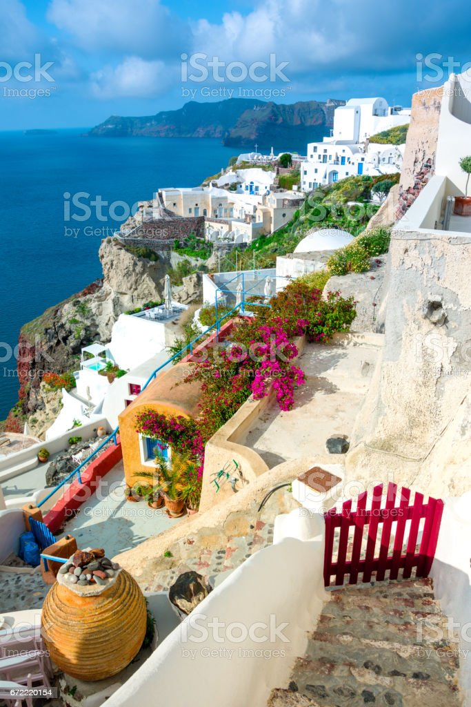 Oia town on Santorini island, Greece. Traditional and famous houses and churches with blue domes over the Caldera, Aegean sea stock photo