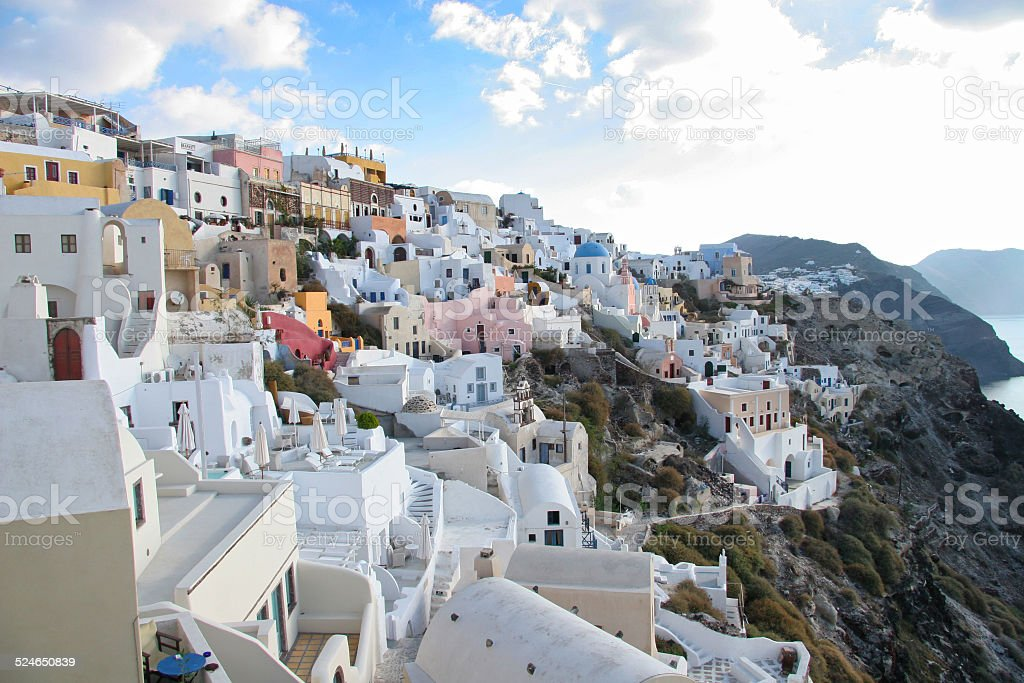 Oia town with buildings on the cliffside, Santorini, Greece. stock photo