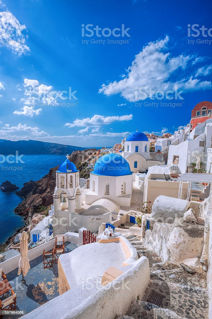 Oia village in Santorini island with famous churches,  Greece stock photo