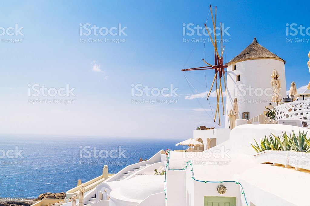 Oia windmill sunset, Greece stock photo