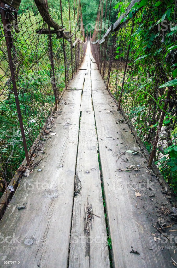 OId ruined rust cable bridge with stock photo
