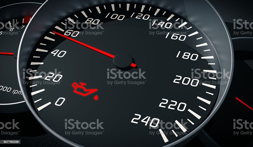 Oil and engine malfunction warning light control in car dashboard. stock photo