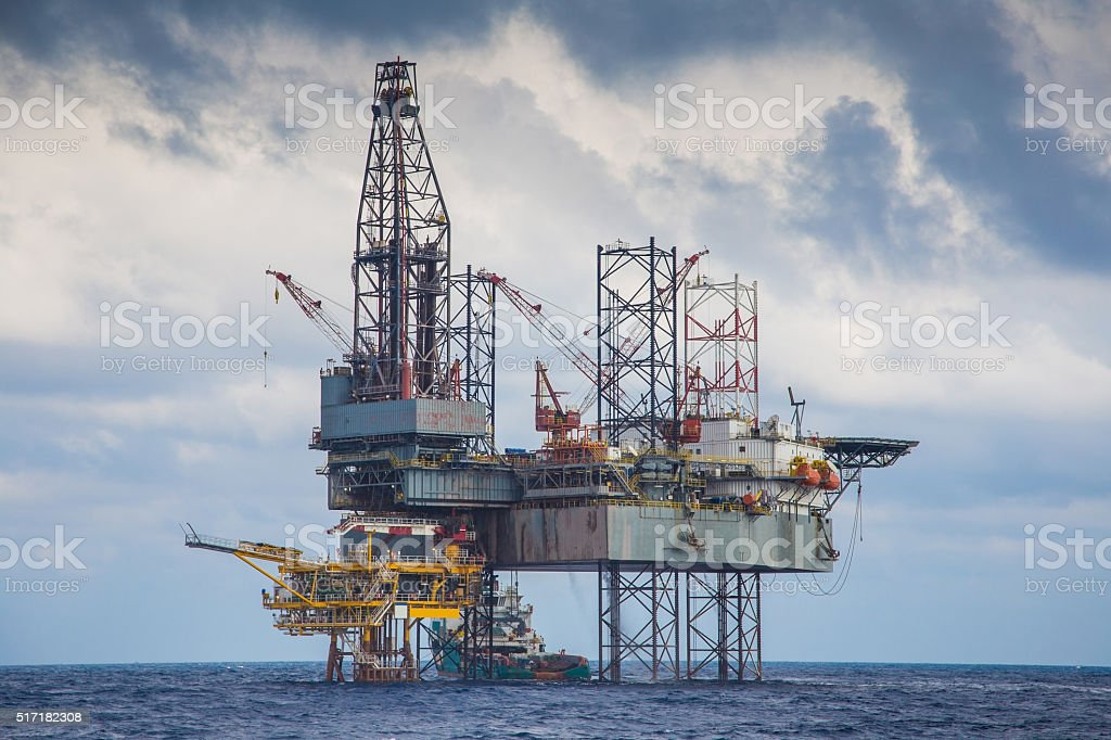 Oil and gas drilling rig work over platform to completion stock photo
