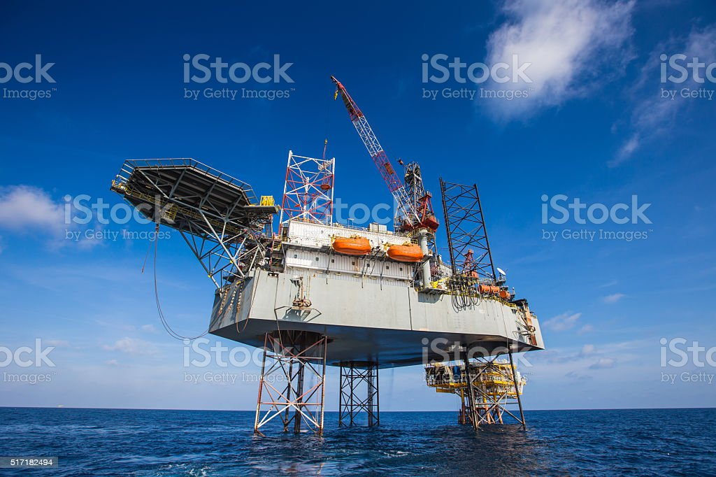 Oil and gas drilling rig workover wellhead platform stock photo