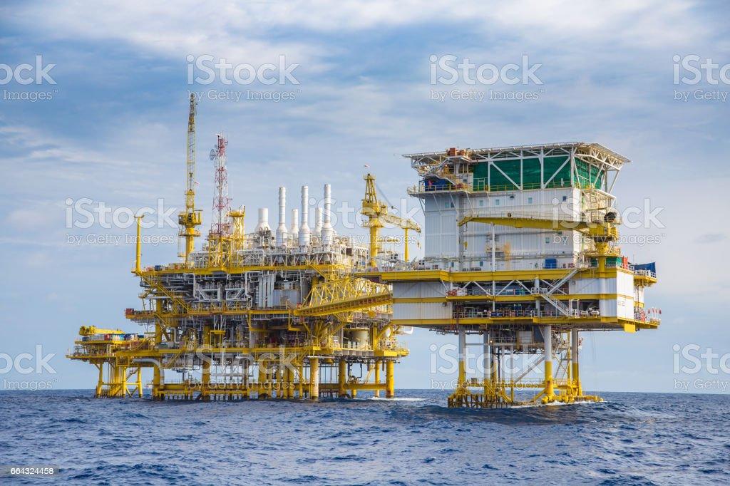 Oil and gas living quarter, oil and gas processing platform and wellhead remote platform in the gulf of Thailand. stock photo