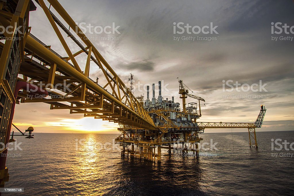 Oil and gas platform during sunrise or sunset stock photo