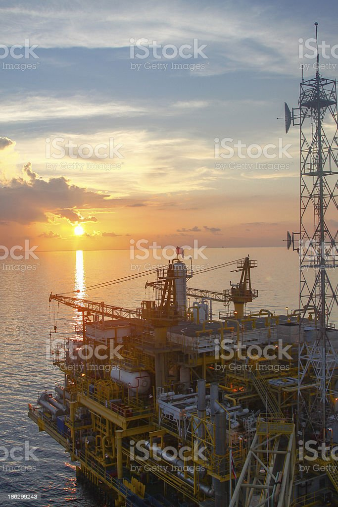 Oil and gas platform in sunset or sunrise time royalty-free stock photo